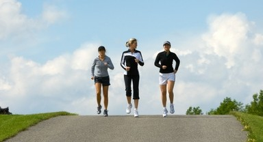 Three Women Jogging Outside On A Sunny Day